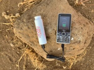 Solar cow charging mobile phone